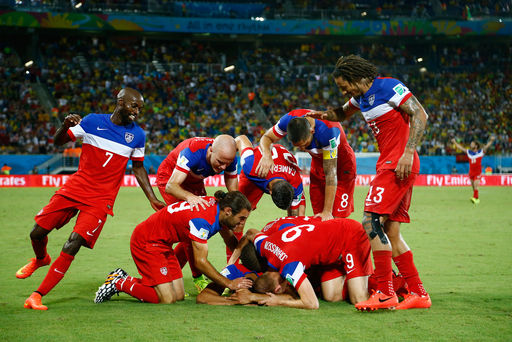 Team U.S.A celebrate during the 2014 World Cup Group G soccer match between Ghana and the U.S. at the Dunas arena